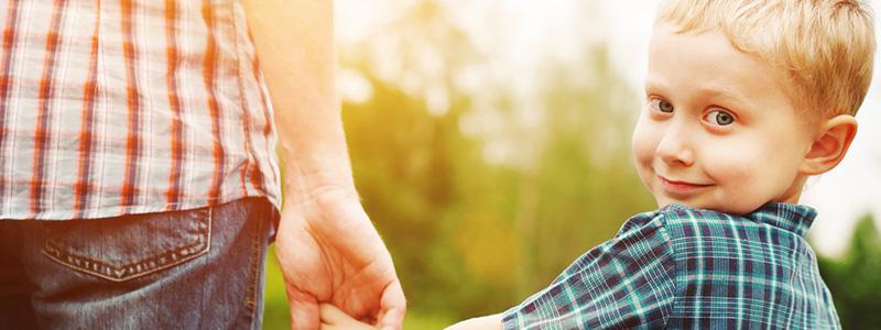 child-holding-hand